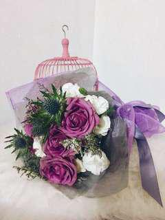 Hand bouquet purple rose