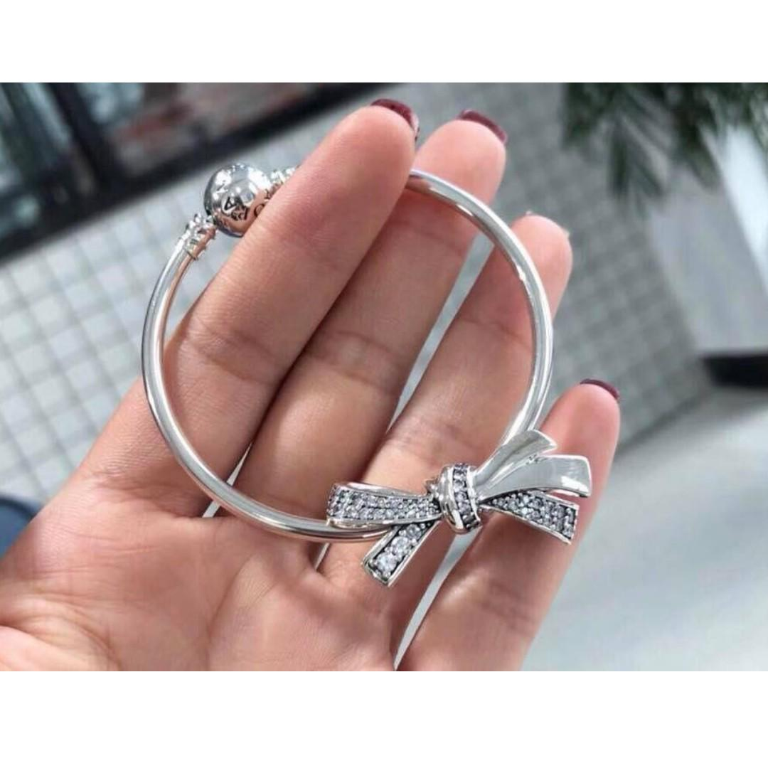 4084fb963 Authentic Pandora Moments Bracelet Bangle with PANDORA Brilliant Bow Charm  with Clear CZ 92.5 Sterling Silver Saudi Gold 18K (Not Pawnable) on  Carousell