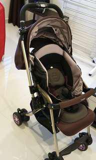 Combi stroller miracle turn purple