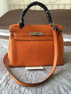 Authentic Hermes Kelly 28 in Orange Clemence leather