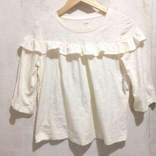 Broken white ruffle blouse