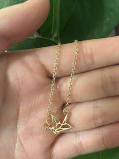 Gold plated paper crane necklace
