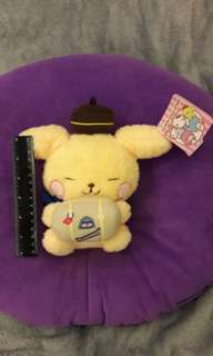 Traveling Pompompurin with suitcase and scarf
