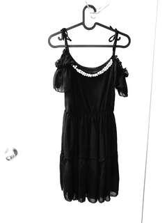 Black Dress with pearls around the kneck
