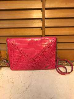 95% new Lancel pink clutch bag