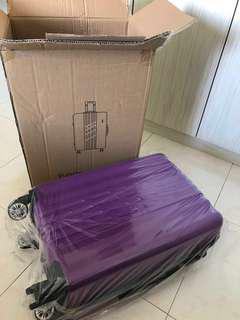 20 inch expandable purple luggage bag 4 wheels (new)