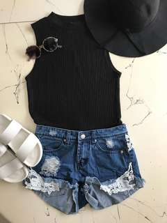 Denim Shorts, Black Top, Hat and White Shoes
