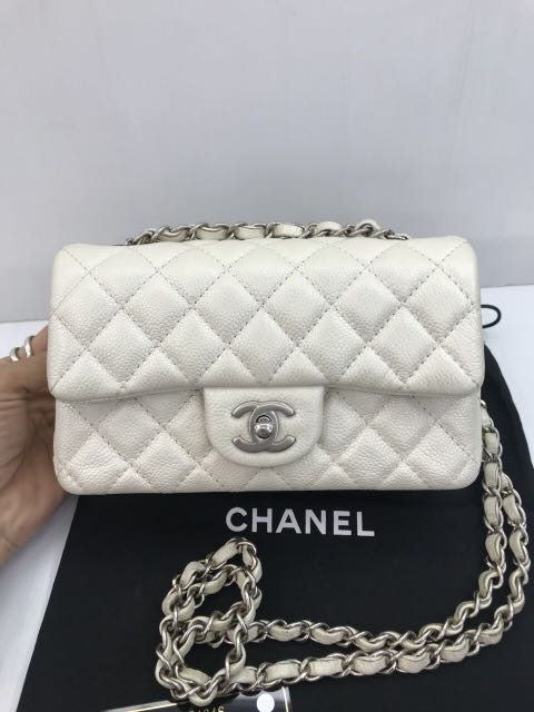 ba1a3611ce102a Chanel pearly white mini, Luxury, Bags & Wallets, Handbags on Carousell