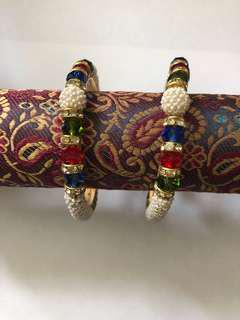 Red, green and blue ceramic bangles