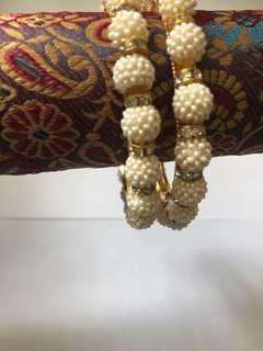 Pearl bangles with beads