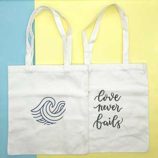 White Canvas Graphic Tote Bag (Waves & Love Never Fails)