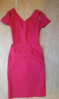 Bodycon dress with shoulder cut outs.
