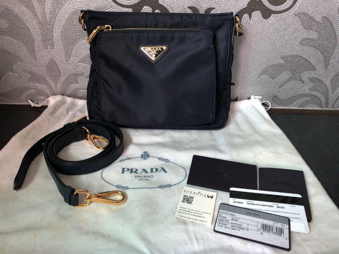 Pre-loved Prada Tessuto   Saffiano Crossbody Bag (Blue) 82444f047ad55