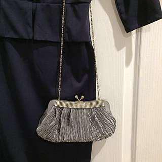 Silver grey clutch bag
