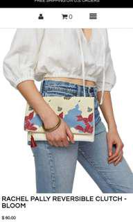 Floral and white vegan leather reversible clutch.  Ever used