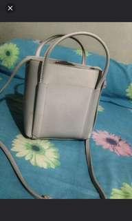 Miniso sling bag cream