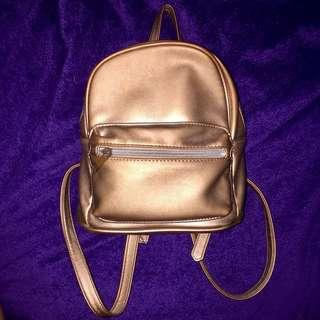 Stradivarius rose gold backpack