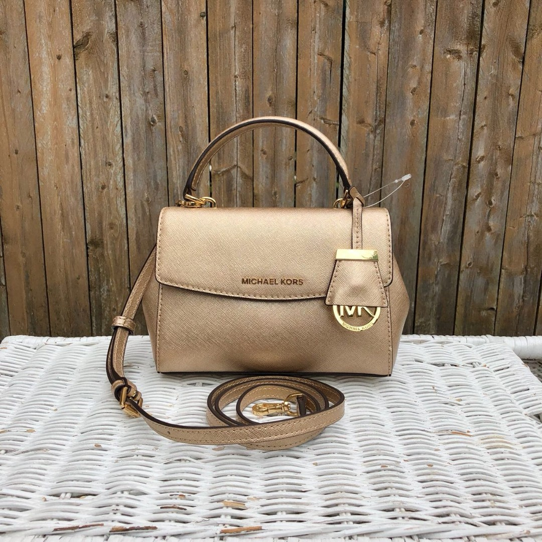 e115a41c94e0 Michael Kors Ava XS Crossbody in Pale Gold, Women's Fashion, Bags ...