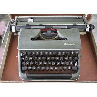 Olympia retro type writer with wooden briefcase