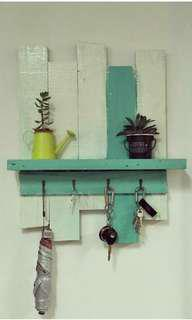 Wooden wall shelf with key holder
