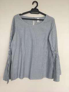 Striped blouse with long bell sleeves