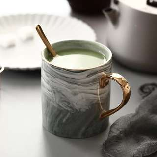 Marble mug with gold handle