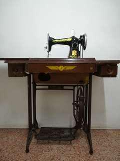 Antique Flying Man Sewing Machine