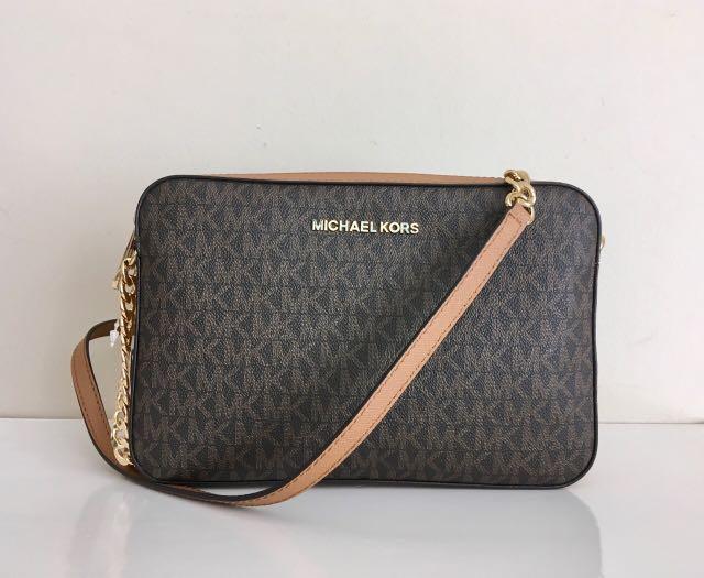 a5ed8c0983524 Authentic Michael Kors Jet Set Signature Sling Bag
