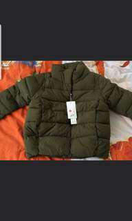 Cute puffer jacket. New with tags.