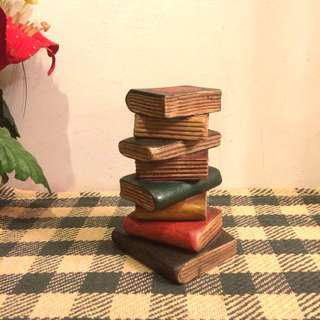 Small teak wood carving stack of books