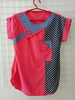 Pink short sleeve blouse with polka dots pattern