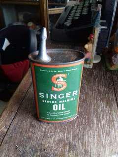 Antique Singer oil dispenser