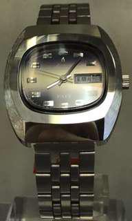 Aroma紫色電視機形機械錶
