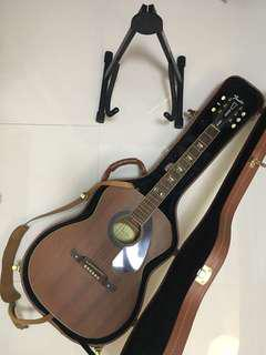 Fender guitar with hard case, guitar stand, capo, strap, and with built in tuner.