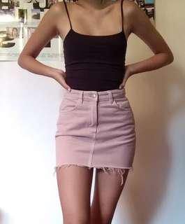 Pastel pink denim mini skirt