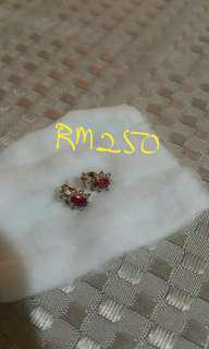 Red Ruby gold earings to let go.