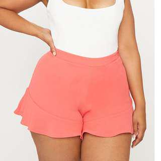 Pretty Little thing -Plus Coral Frill Hem Shorts -(size 26)