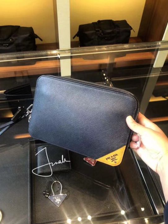 3a2cc4e9634f14 Prada clutch [SALE], Luxury, Bags & Wallets, Clutches on Carousell