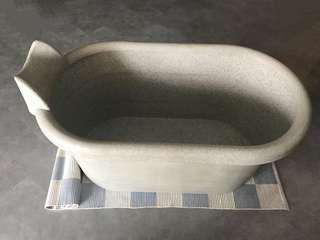 Portable bath tub with rubber stopper.