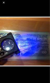 Uv light with magnifying