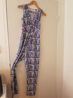 70s style womens jumpsuit in retro print. Size 8