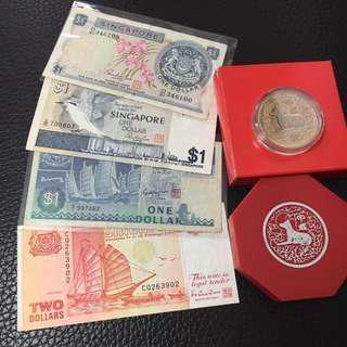 CNY Souvenir gift pack, Singapore collectible various currencies comprising $10 cupro-nickel coin year of the Dog 1994 and 4 paper note altogether current value $15