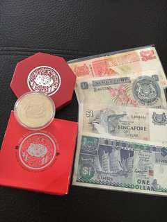 CNY Souvenir gift pack, Singapore collectible various currencies comprising $10 cupro-nickel coin year of the Boar 1995 and 4 paper note altogether current value $15, only the Orchard note & & red $2 was used.