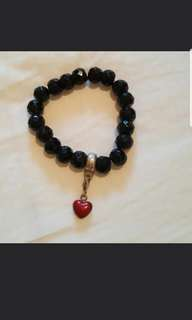 Thomas Ravi bracelet and charm
