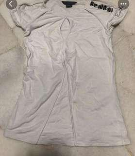 White t-shirt top with pearl drop neckline and Armani Exchange print on left shoulder