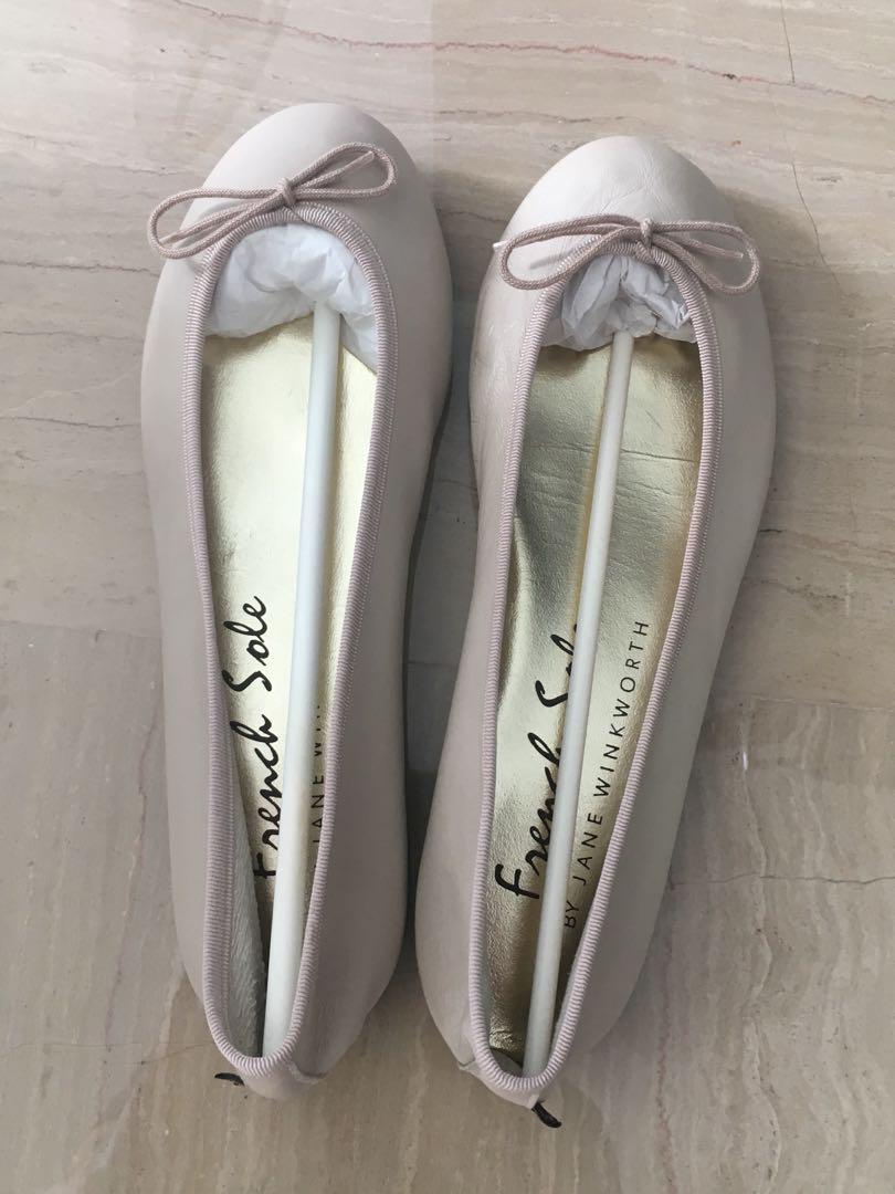 A pair of french sole ballet flats