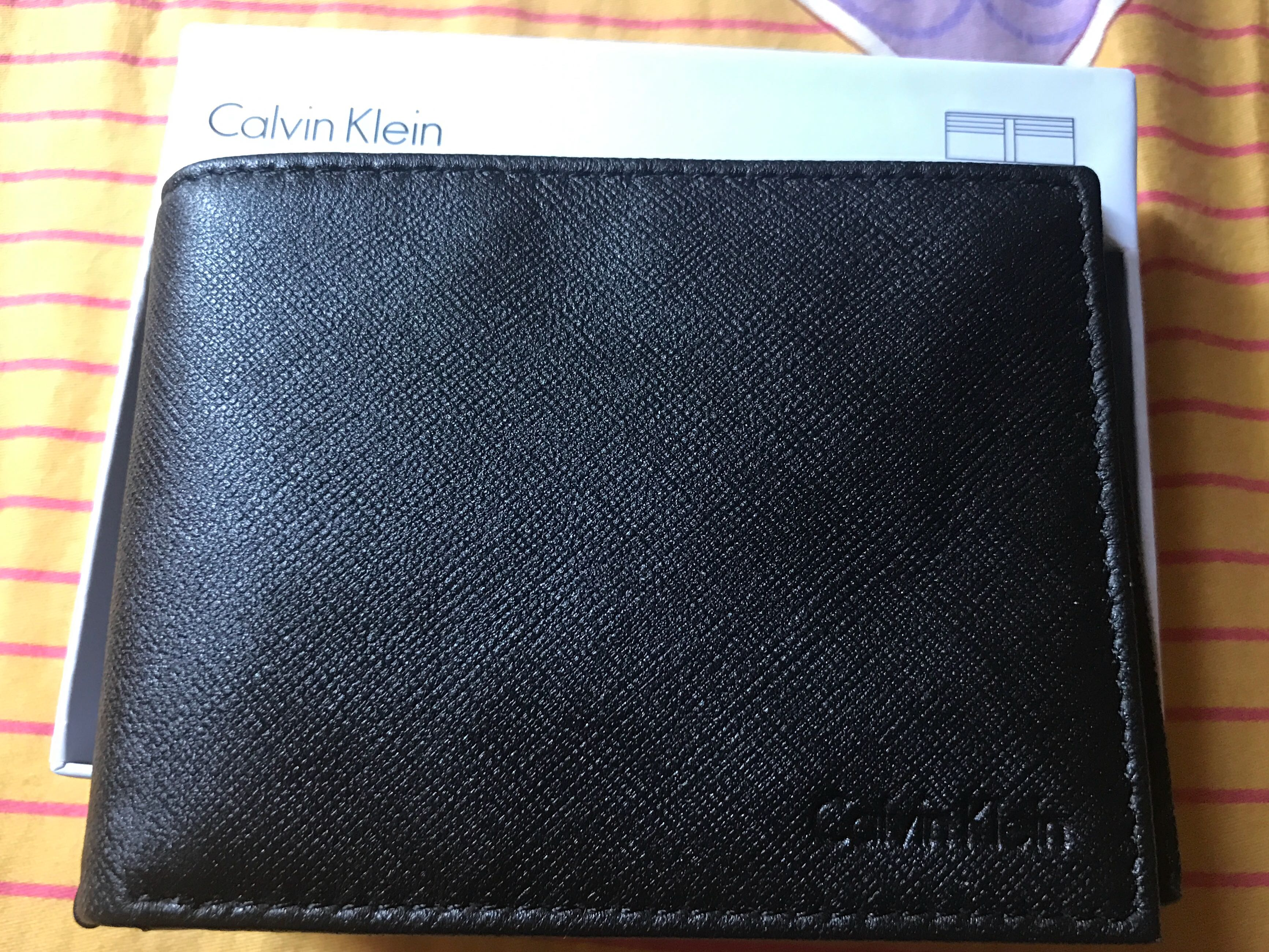 5c24df6d61881 Calvin Klein men wallet black leather, Men's Fashion, Bags & Wallets,  Wallets on Carousell