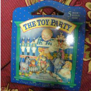 "Hard bound book ""The Toy Party"" A read and play carry puzzle book"