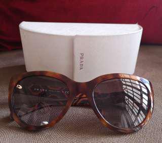 PRADA Sun Glasses in Brown Tortoise
