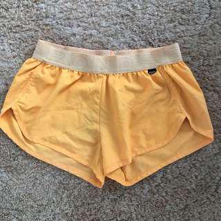Orange gym shorts